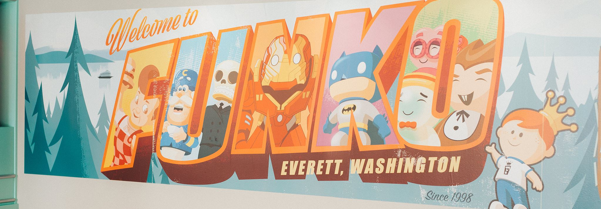 A postcard-like wall painting says 'Funko'
